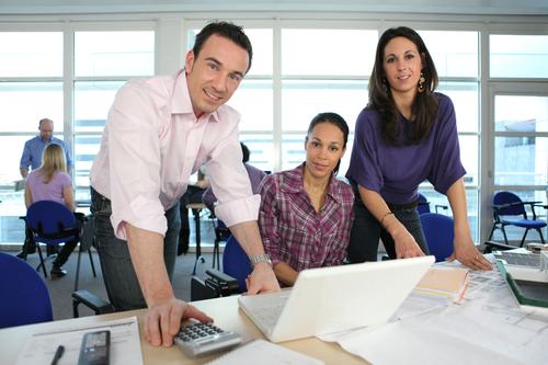 Creative team working round a laptop