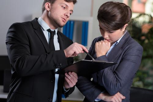 Strict boss talking with secretary